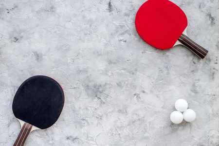 Sport background. Ping pong racket on grey background top view copyspace