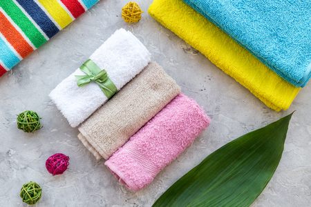 Wash clothes. Clean towel on grey stone background top view Stock Photo