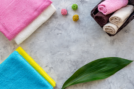 Wash clothes. Clean towel on grey stone background top view copyspace Stock Photo - 83143521