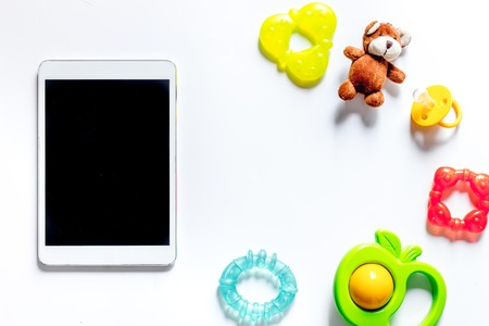 Mockup for adoption concept. Tablet PC on white background top view. Stock Photo