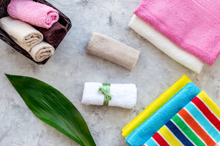 Fresh towel after washing on grey stone background top view. Stock Photo - 83282876
