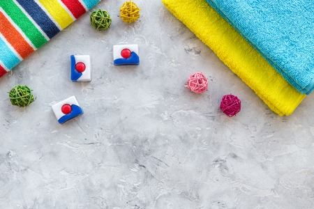 Laundry. Bars of dry detergent near clean towel on grey stone background top view. Stock Photo - 83283026