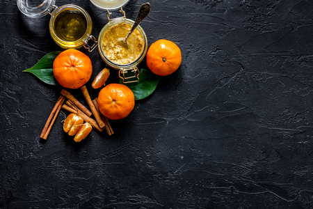 Porrige for breakfast with oranges and honey on black stone background top view.