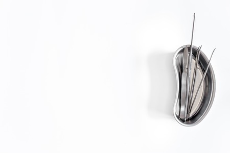 urologist: Urologist tools and flask on white background.