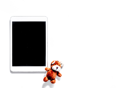 Mockup for adoption concept. Tablet PC on white background top view. 版權商用圖片