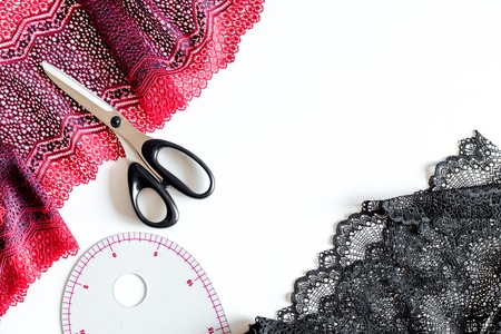 Clothing designer workplace. White background top view. Stock Photo