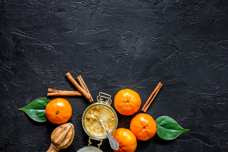 Porrige for breakfast with oranges and cinnamon on black stone background top view copyspace