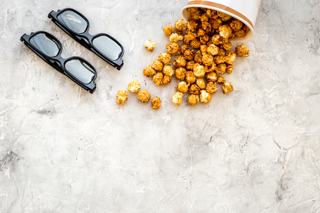 Snacks for film watching. Popcorn and soda near glasses on grey background top view copyspace Stock Photo