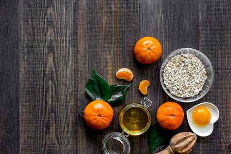 Sweet summer breakfast. Oatmeal, oranges, honey, sugar on wooden table background top view copyspace Banco de Imagens