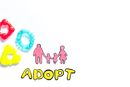 Adopt word, paper silhouette of family and toys on white background top view copyspace 版權商用圖片 - 83464593
