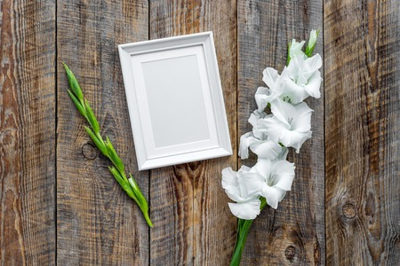 Blank photo frame near flower gladiolus on rustic wooden background top view mockup copyspace Stock fotó - 83531362