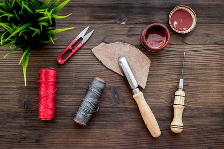 Leather craft workshop. Tools on dark wooden table Zdjęcie Seryjne