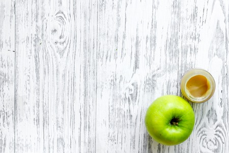 Apple puree for baby on light wooden table background top view copyspace Stock Photo
