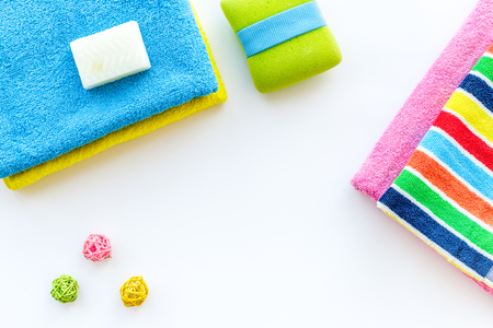 Preparing to take bath. Towels and soap on white background top view copyspace 版權商用圖片