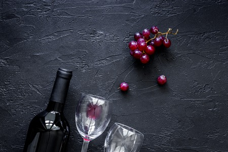 Wine glasses on black stone table background top view . Stock Photo