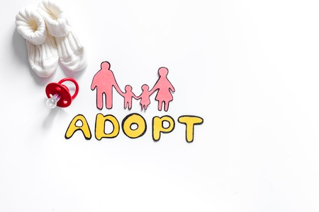 daughter in law: Adopt word, paper silhouette of family and toys on white background top view copyspace