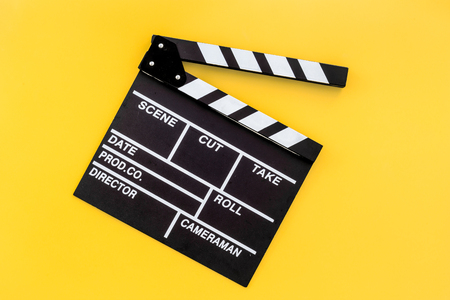 Filmmaker profession. Clapperboard on yellow background top view copyspace Stok Fotoğraf