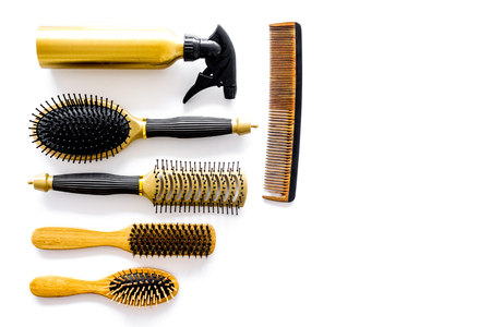 Combs and hairdresser tools in beauty salon on white background top view copyspace