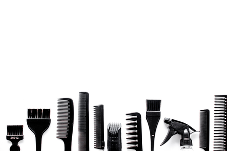 hairdresser: Combs and hairdresser tools in beauty salon on white background top view copyspace