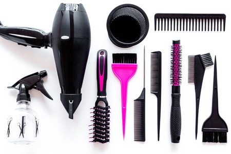 Combs and hairdresser tools in beauty salon on white background top view Stock fotó