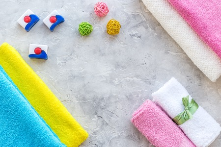 Laundry. Bars of dry detergent near clean towel on grey stone background top view. Stock Photo - 84043024