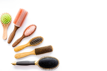 hairdresser: Set of combs in beauty salon on white background top view copyspace