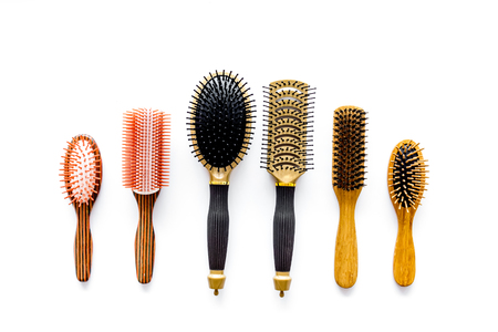 Set of combs in beauty salon on white background top view copyspace