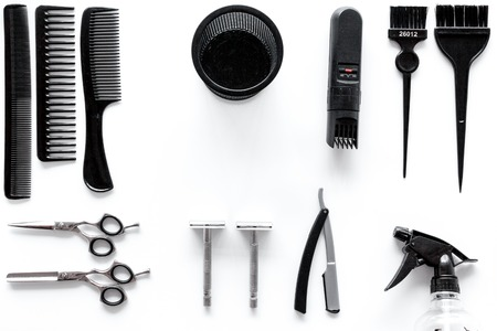 barbershop: Combs and hairdresser tools in beauty salon on white background top view. Stock Photo