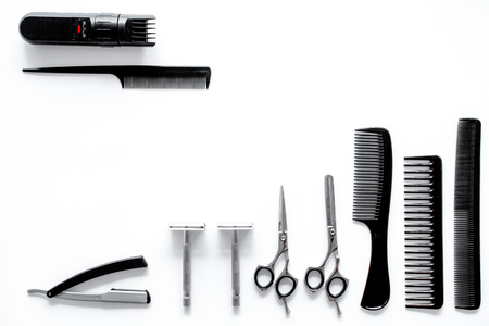 Combs and hairdresser tools in beauty salon on white background top view. Stock Photo