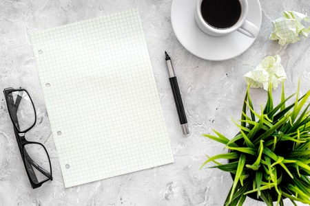 Plan for the year. Notebook, pen, glasses, cup of coffee on grey stone background top view. Stock Photo - 84111128