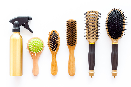 combs and hairdresser tools for styling on white work desk background top view