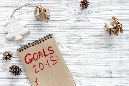 Set a goal for new year. Notebook on grey wooden background top view. Stock Photo