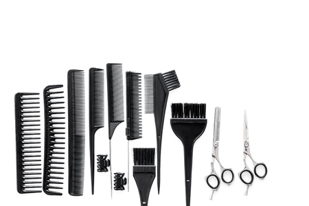 hairdresser working desk space with tools for hair styling on white desk background top view mock up