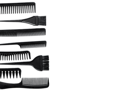 combs and hairdresser tools for styling on white work desk background top view mockup