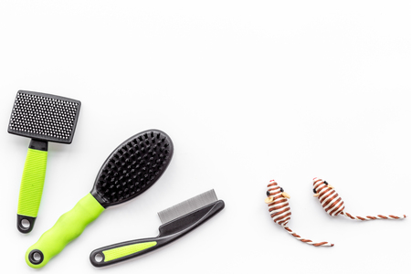 care about pet with brushes and grooming equipment on white background top view mockup