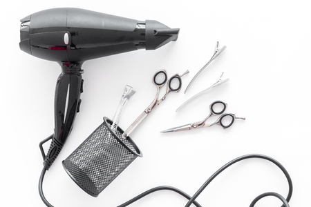 hairdresser working desk space with tools for hair styling on white desk background top view Stock Photo
