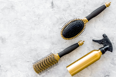 styling hair instruments with combs and brushes in barbershop on stone desk background top view mockup