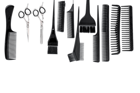 styling hair with combs and hairdresser tools in barbershop on white background top view mock-up