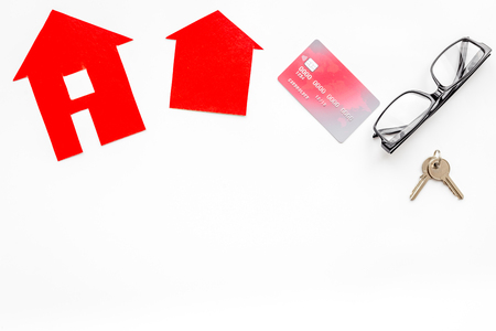apartment for rent: selling property online set with paper house on office desk white background top view mockup Stock Photo