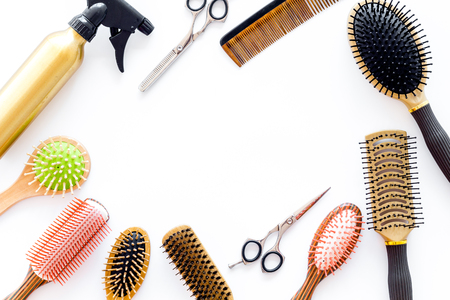 styling hair with combs and tools in barbershop on white background top view mock-up