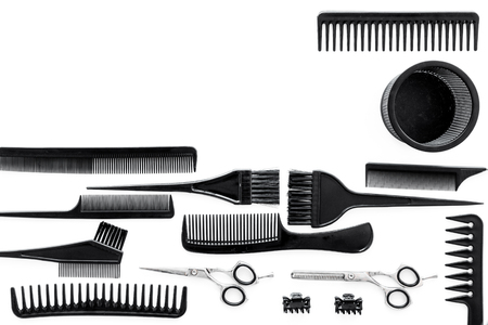 combs and hairdresser tools on white work desk background top view mockup