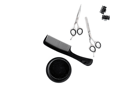 hairdresser work desk with tools for hair styling on white background top view space for text