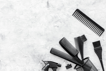styling hair with combs and tools in barbershop on stone background top view mock-up Stock Photo