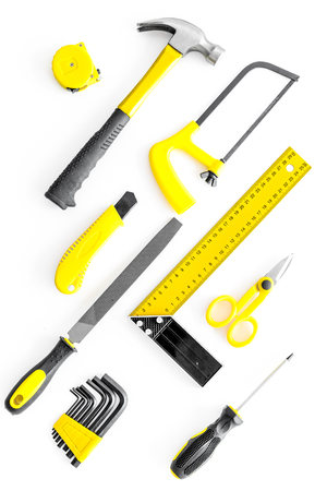 set of tools for build and repair house on white desk background top view