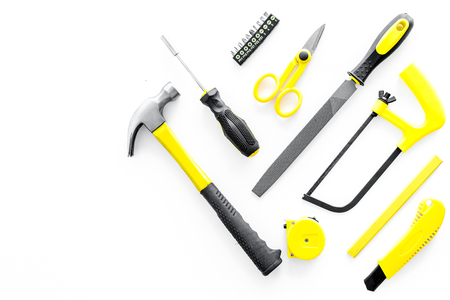 set of tools for build and repair house on white desk background top view mock-up