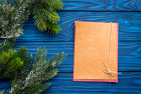 Christmas eve set with spruce branches and notebook for resolutions on blue wooden desk background top veiw mock-up Stock Photo