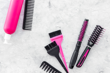 Styling hair instruments with combs and brushes in barbershop on stone desk background top view mockup Stock Photo