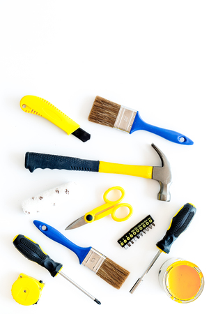building, painting and repair tools for house constructor work place set on white background top view space for text
