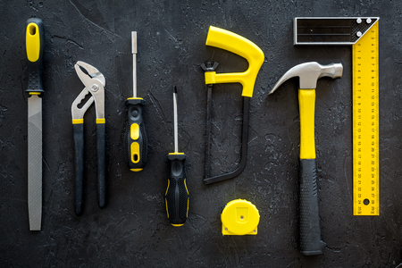 set of tools for build and repair house on dark desk background top view Stock Photo
