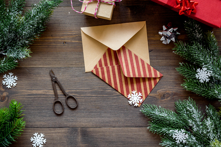new year 2018 celebration with envelopes and boxes on wooden desk background top veiw